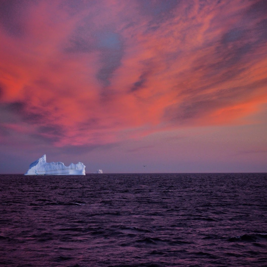 Icebergs and sunset off the west coast of Greenland.